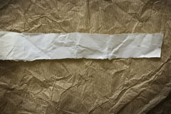 Old brown paper with tape Stock Images