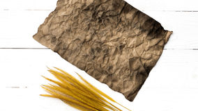 Old brown paper and wheat Stock Photos