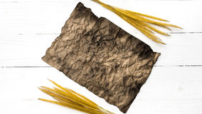 Old brown paper and wheat Royalty Free Stock Photo
