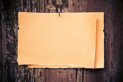 Old brown paper on wood board background Stock Photography