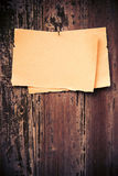 Old brown paper on wood board background Royalty Free Stock Photo