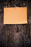 Old brown paper on wood board background Stock Image