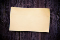 Old brown paper on wood board background Royalty Free Stock Photography