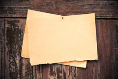 Old brown paper on wood board background Stock Photos