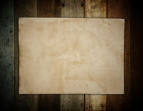 Old brown paper on wooden wall background for texture Stock Photo