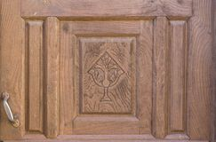 Old brown run-down religious decorated wooden door Stock Photography