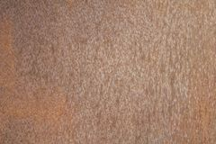 Old brown rusty metal sheet with dots. rough surface texture. A old brown rusty metal sheet with dots. rough surface texture stock photos