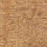 Old brown sacking backdrop. Surface of an old brown sacking backdrop royalty free stock image