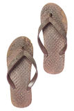 Old brown sandals on isolate white background. Very dirty slippers stock image