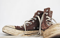 Old brown sneakers Stock Photos
