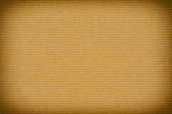 Old brown striped paper background. With vignette stock photography