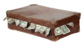 Old brown suitcase with dollars Royalty Free Stock Images