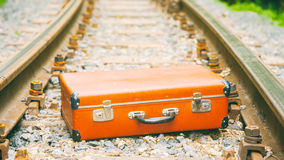 Old brown suitcase on the railway Royalty Free Stock Images