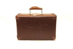 Old brown suitcase on a white background. Old brown suitcase on white background Stock Photo