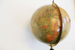 Old brown terrestrial globe. With a view of the African Continent Stock Images