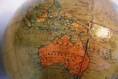 Old brown terrestrial globe. With a view of the  Australia Continent Stock Image