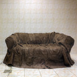 Old brown textile couch in bathroom Royalty Free Stock Image