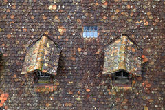 Old brown tile roof with dormer Royalty Free Stock Photography