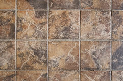 Old brown tile wall background Royalty Free Stock Image