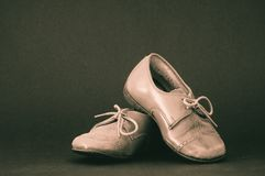 Old brown toddler shoes Stock Images