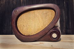 Old brown vintage bakelite Tesla radio on wooden background Royalty Free Stock Images