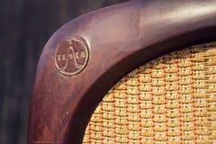 Old brown vintage bakelite Tesla radio on wooden background Royalty Free Stock Photos