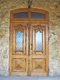 Old brown vintage wooden door with decoration Royalty Free Stock Image