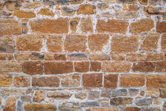 Old brown wall with bluish nuances. Old brown stone wall of rough natural stones with partially bluish nuances, taken in close-up Stock Photos