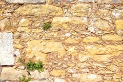 Old brown wall with stone masonry, background.  Royalty Free Stock Image