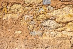 Old brown wall with stone masonry, background.  Stock Images