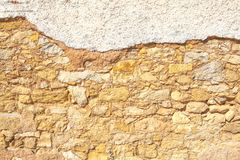 Old brown wall with stone masonry, background.  Royalty Free Stock Photo