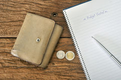Old brown wallet with budgeting plan Royalty Free Stock Photos