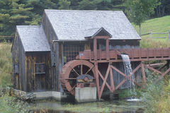 An old brown water mill Stock Images