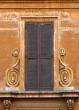 Old brown window shutters Stock Images