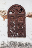 Old brown window. On wethered white wall Stock Images