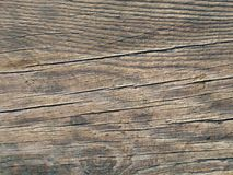 Old brown wood board surface texture photo. Old brown wood board surface texture. Close-up of damaged wooden floor background Stock Photos