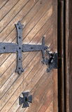 Old brown wood door with impressive hardware Stock Photography