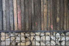 Old brown wood and stone in iron net wall texture background pat. Tern stock photography