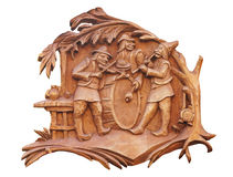 Old brown wooden bass-relief with musicians isolated over white Stock Photo