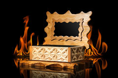 Old brown wooden casket in fire flame on black background Royalty Free Stock Photos
