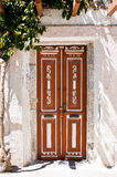 Old brown wooden Door and green bush Royalty Free Stock Photography