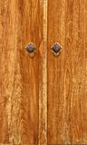 Old Brown Wooden Door with two Vintage Lion Head handle Royalty Free Stock Photo