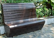 Old Brown Wooden Park Bench at A Park Royalty Free Stock Image