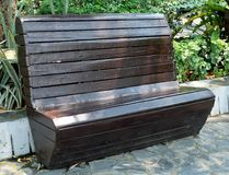 Old Brown Wooden Park Bench at A Park Stock Image
