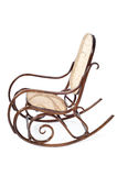 Old brown wooden rocking chair Stock Images