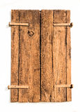 Old brown wooden shutters formed from cracked aces. Royalty Free Stock Photography