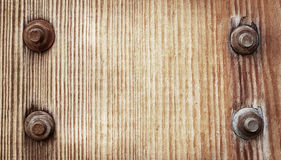 Old brown wooden texture with metal screw Royalty Free Stock Photo