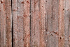 Old brown wooden wall, detailed background photo texture. Wood plank fence close up Royalty Free Stock Photo