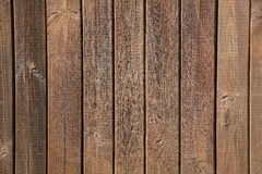 Old brown wooden wall, detailed background photo texture. Wood plank fence close up Royalty Free Stock Photos