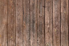 Old brown wooden wall, detailed background photo texture. Wood plank fence close up Royalty Free Stock Images